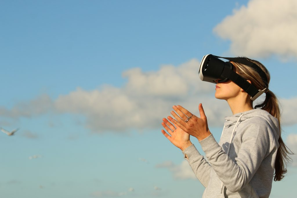 a picture of a woman wearing a virtual reality headset